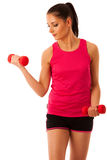 Active young woman workout with dumbbells in fitness gym isolate Stock Photos