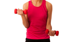 Active young woman workout with dumbbells in fitness gym isolate Stock Photography