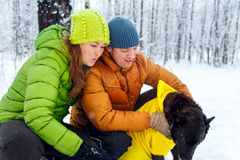 Activefamily walk the dog in the winter forest. Stock Photography