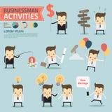 Actividades del hombre de negocios en fondo azul Fotografía de archivo