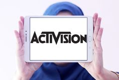 Activision company logo. Logo of Activision company on samsung tablet holded by arab muslim woman. Activision Publishing, Inc. is an American video game Royalty Free Stock Photos