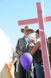 Activist Javier Sicilia behind pink cross Royalty Free Stock Photos