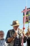 Activist Javier Sicilia holding pink cross Stock Photography