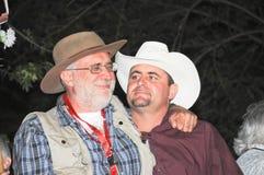 Activist Javier Sicilia hugs julian Lebaron Stock Images