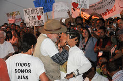 Activist Javier Sicilia kisses woman Royalty Free Stock Photos