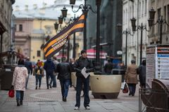 Activist of NOD National Liberation Movement handing out leaflets in the city centre. ST. PETERSBURG, RUSSIA - MAY 5, 2018: Activist of NOD National Liberation royalty free stock photos