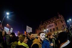 Activistas en las demostraciones de noviembre de 2015 en Bucarest Imagen de archivo libre de regalías