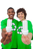 Activists holding energy saving light bulbs Royalty Free Stock Image