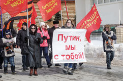Activists of the `National Liberation Movement` NOD, carry a poster with the inscription `Putin, we are with you!`. The picture was taken in Russia, in the city stock photos