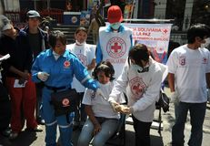 Activists of the red cross teach people first aid on a city street. Stock Photography
