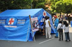 Activists of the red cross teach people first aid on a city street. Royalty Free Stock Image
