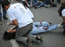 Activists of the red cross teach people first aid on a city street. Stock Photos
