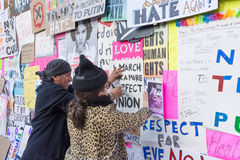 Activists staples protest posters on the wall Royalty Free Stock Photography