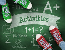 Activities against green chalkboard Stock Images
