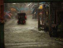 Activities, Boat Ride in the rain in Rainy season at Damnoen Saduak Floating Market, Ratchaburi, Thailand. Activities, Boat Ride in the rain in Rainy season at Royalty Free Stock Photography