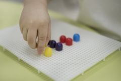 Activities for Kids. Simple Fine Motor Skills Activity for children. great way to teach a toddler or a preschooler to stock images