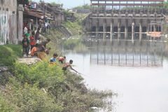 Activities play catch fish in the dam floodgate Stock Photos