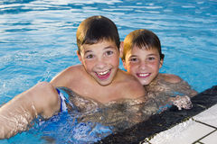Activities on the pool. boys swimming and playing in water Stock Image