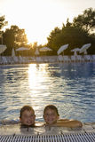 Activities on the pool. Boys swimming and playing in water Stock Photo