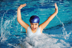 Activities on the pool, children swimming Royalty Free Stock Photos