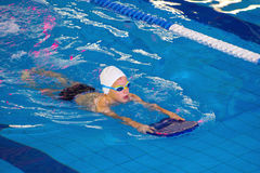 Activities on the pool children swimming fitness, competition Stock Images