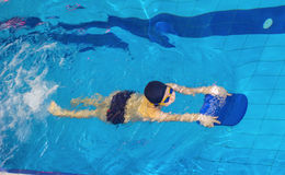 Activities on the pool children swimming fitness, competition Royalty Free Stock Photos