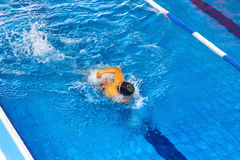 Activities on the pool children swimming fitness, competition Royalty Free Stock Photography