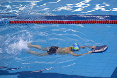 Activities on the pool children swimming fitness, competition Stock Photo