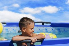 Activities on the pool, children swimming and playing in water, happiness and summertime. The Activities on the pool, children swimming and playing in water stock images