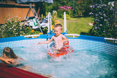 Activities on the pool, children swimming and playing in water Stock Photo