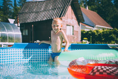 Activities on the pool, children swimming and playing in water Stock Images