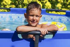 Activities on the pool, children swimming and playing in water, happiness and summertime. The Activities on the pool, children swimming and playing in water royalty free stock photos