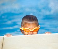 Activities on the pool. Cute boy in swimming pool Stock Photo