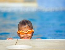 Activities on the pool. Cute boy in swimming pool Royalty Free Stock Photo