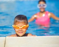 Activities on the pool. Cute boy in swimming pool Stock Images