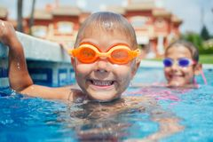 Activities on the pool. Cute boy in swimming pool Royalty Free Stock Photos