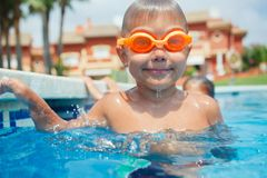 Activities on the pool. Cute boy in swimming pool Royalty Free Stock Image