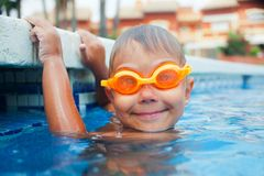 Activities on the pool. Cute boy in swimming pool Royalty Free Stock Images