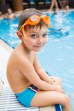 Activities on the pool. Cute boy in swimming pool stock image