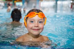 Activities on the pool. Cute boy in swimming pool Royalty Free Stock Photography
