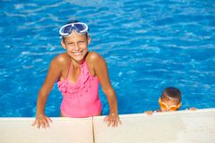 Activities on the pool. Cute girl in swimming pool stock photos