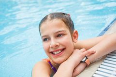 Activities on the pool. Cute girl in swimming pool Royalty Free Stock Image