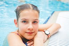 Activities on the pool. Cute girl in swimming pool Stock Photo
