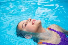 Activities on the pool. Cute girl in swimming pool Stock Images