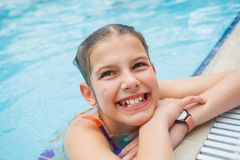 Activities on the pool. Cute girl in swimming pool Royalty Free Stock Images
