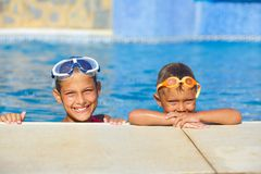 Activities on the pool. Cute kids in swimming pool Stock Photos