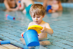 Activities on the pool, toddler boy swimming Royalty Free Stock Photo