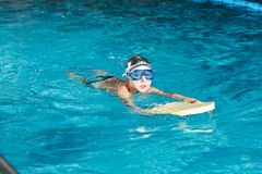 Activities on the pool young boy swimming fitness Stock Image