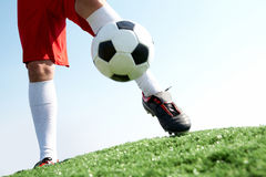 Activity. Horizontal image of soccer ball being kicked by footballer Royalty Free Stock Photos
