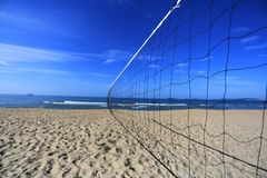 Volleyball net on the beach and seascape on the sunrise in morning. Activity, background, ball, beach, blue, empty, exercise, fun, game, holiday, lifestyle royalty free stock image